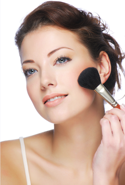 woman-applying-mineral-makeup-blush-face.png